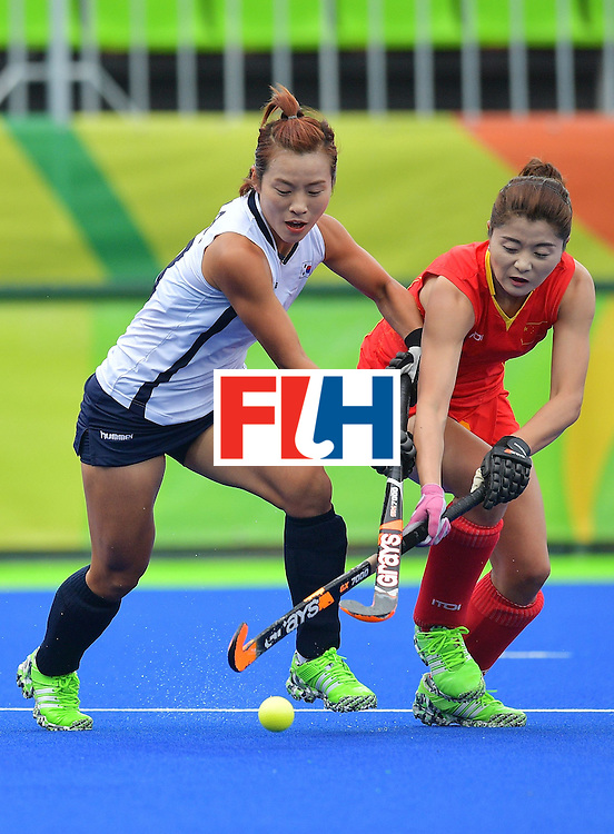 China's De Jiaojiao (R) and South Korea's Kim Bomi vie for the ball during the womens's field hockey South Korea vs China match of the Rio 2016 Olympics Games at the Olympic Hockey Centre in Rio de Janeiro on August, 12 2016. / AFP / Carl DE SOUZA        (Photo credit should read CARL DE SOUZA/AFP/Getty Images)