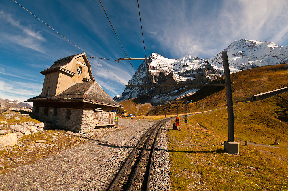 Jungfrau Railway train climbing from Kleine Scheidegg to Eigergletscher, Swiss Alps, Canton Bern, Switzerland