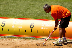 Arranging the sand during the Womens Long Jump Qualifying during day one of the 20th European Athletics Championships at the Olympic Stadium on July 27, 2010 in Barcelona, Spain. (Photo by Vid Ponikvar / Sportida)