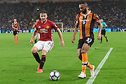 Manchester United player Luke Shaw (23) and Hull City midfielder Ahmed Elmohamady (27)  during the Premier League match between Hull City and Manchester United at the KCOM Stadium, Kingston upon Hull, England on 27 August 2016. Photo by Ian Lyall.