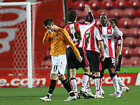 Photo: Lee Earle/Sportsbeat Images.<br /> Southampton v Hull City. Coca Cola Championship. 08/12/2007. Hull's Bryan Hughes (L) looks dejected as Southampton celebrate their third.