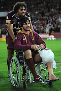 July 6th 2011: Sam Thaiday wheels injured Maroon Johnathan Thurston on to the stage after game 3 of the 2011 State of Origin series at Suncorp Stadium in Brisbane, QLD, Australia on July 6, 2011. Photo by Matt Roberts / mattrimages.com.au / QRL