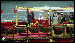 The Queen and the Duke of Edinburgh along with Prince Charles and the Duchess of Cornwall wave to crowds lined up on the side of the Thames as they take part in the River Pageant with a flotilla of a 1,000 boats accompanying The Queen and the Royal Family down the Thames to mark the Queen's Diamond Jubilee. Sunday June 3, 2012 Photo by Andrew Parsons/i-Images