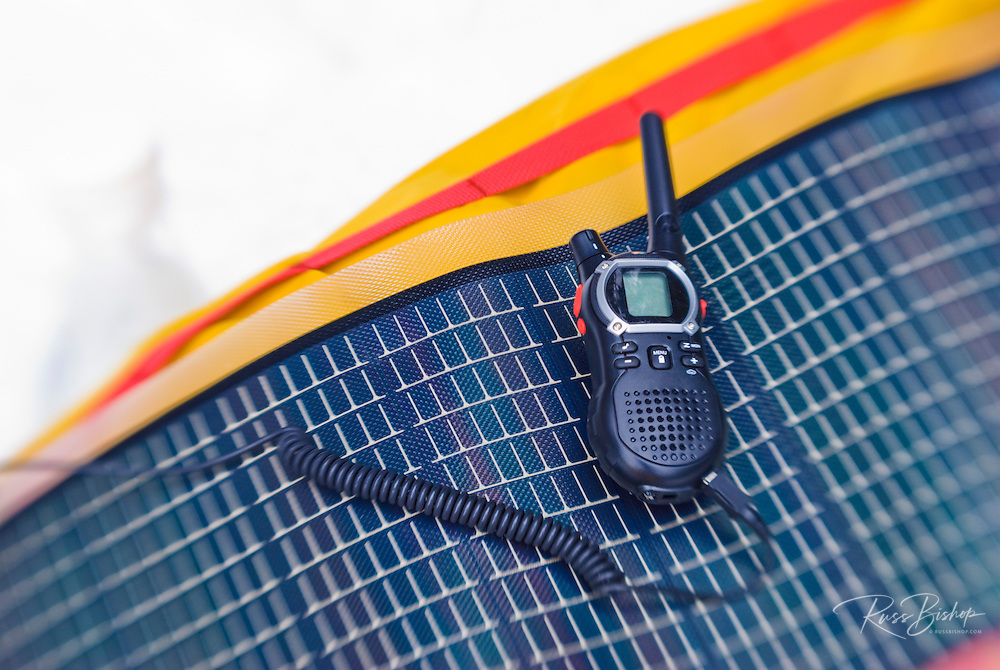 Portable solar panel charging a radio in the backcountry, Sequoia National Park, California USA