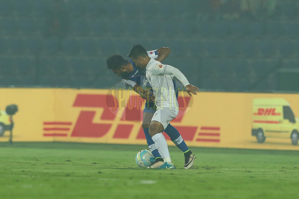 Subhasish Bose of Bengaluru FC and Seiminlen Doungel of Northeast United FC during match 19 of the Hero Indian Super League between NorthEast United FC and Bengaluru FC held at the Indira Gandhi Athletic Stadium, Guwahati India on the 8th December 2017<br /> <br /> Photo by: Ron Gaunt / ISL / SPORTZPICS