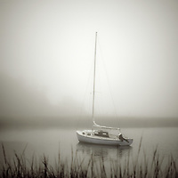 Sailboat anchored in a quiet harbor, Cape Cod, Massachusetts, USA