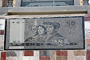 The great wall of cash: Chinese farmer builds new villa featuring huge banknotes in walls so that his ex-wife knows what she's missing out on <br /> <br /> A Chinese farmer had banknotes engraved into the side of his home to show his estranged wife what she is missing.<br /> <br /> Zhao Mashui, 53, paid for giant carvings of currencies to show the mother of his children, who reportedly left him 20 years ago, that he had been a success without her. <br /> <br /> He paid for enlarged versions of the two, five, 50 and 100 Renmenbi notes, 1000 Hong Kong dollars and an American 100-dollar-bill to be carved on a 20-metre wall, <br /> <br /> Mr Zhao said he had to act as both mother and father to his four daughters and one son after she left.<br /> <br /> 'I just don't want my wife to look down upon me. I am able to build a new house and support my family well,' he said, <br /> The father-of-five came up with the idea when he decided to renovate the wall last June. <br /> <br /> Only one wall has banknotes at the moment but Mr Zhao plans to put them on all four walls before long.<br /> <br /> 'If you come this time next year, you'll see hundreds of banknotes on the wall by then,' added Zhao. <br /> With their intricate pattern and realistic colour, each note took specialists two days to complete, costing more than thirty thousand yuan (£3100) so far.<br /> <br /> His house in Jinjingfu village in Quanzhou City, Fujian province, has now become popular with locals who want to visit the wall of cash.<br /> ©Exclusivepix Media
