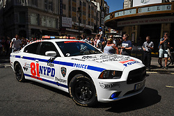 © Licensed to London News Pictures. 05/08/2018. LONDON, UK. A Hot Wheels inspired police car sets off from the start.  Gumball 3000, a charity rally for supercars and more, including celebrity entrants, begins in Covent Garden with 150 participants beginning their journey from London to Tokyo.  Photo credit: Stephen Chung/LNP