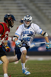 23 April 2010: North Carolina Tar Heels  midfielder Michael Burns (26) during a 13-5 loss to the Maryland Terrapins in the first round of the ACC Tournament at Byrd Stadium in College Park, MD.