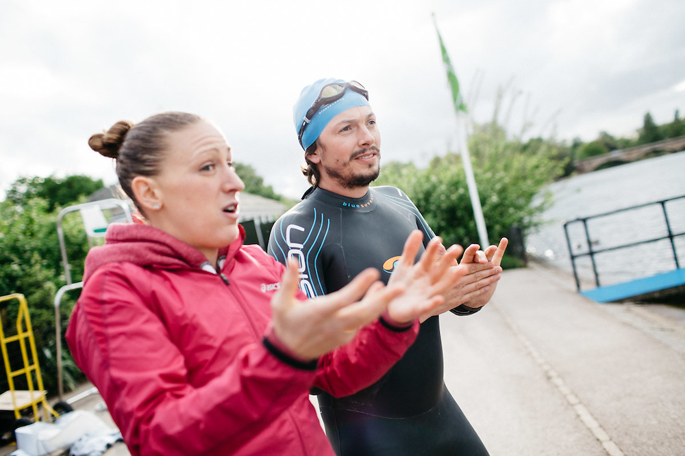 British professional triathlete Jodie Stimpson teaches journalist, Oliver Pickup, swimming techniques. 6th May 2015, London. Photographed by Greg Funnell for the Financial Times.