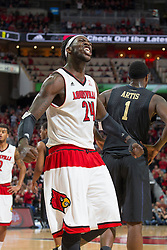 Louisville forward Montrezl Harrell celebrates a blocked shot by forward Anas Mahmoud in the second half. <br /> <br /> The University of Louisville hosted the University of Pittsburgh, Wednesday, Feb. 11, 2015 at Yum Center in Louisville. <br /> <br /> Photo by Jonathan Palmer