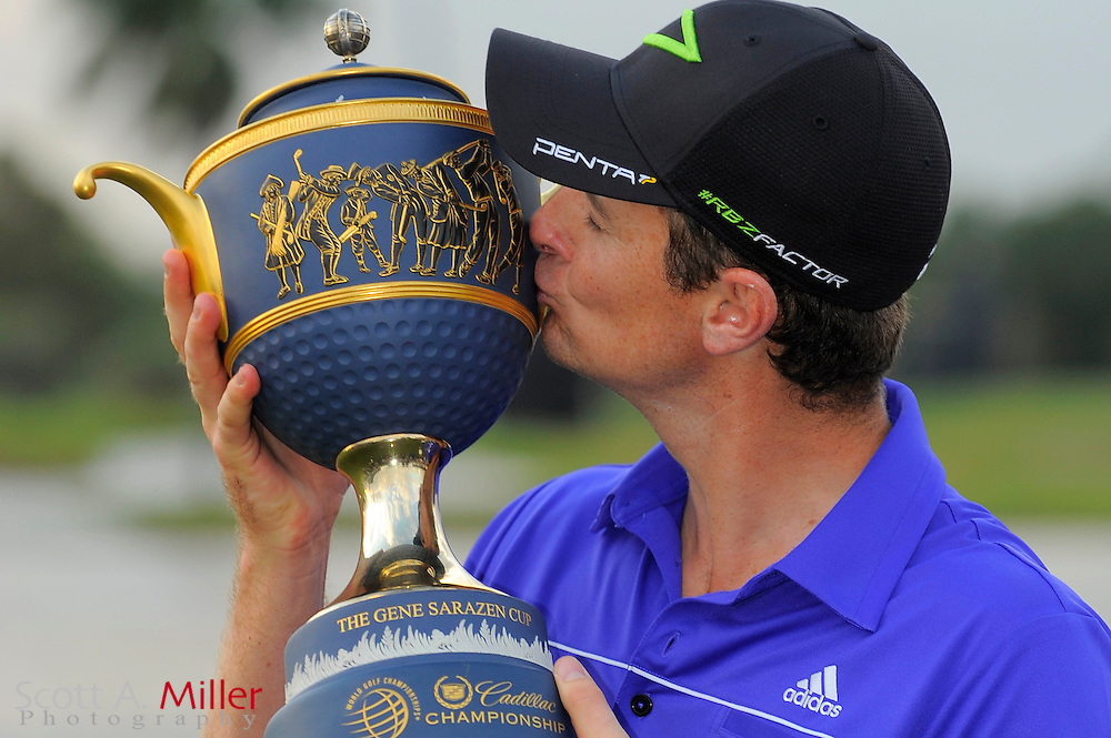Justin Rose with the Gene Sarazen Cup after winning the World Golf Championship Cadillac Championship on the TPC Blue Monster Course at Doral Golf Resort And Spa on March 11, 2012 in Doral, Fla. ..©2012 Scott A. Miller..