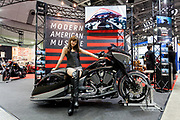 A model poses on a large American motorcycle by Victory at the 44th annual Tokyo Motorcycle show. Tokyo Big Sight exhibition hall, Odaiba, Tokyo, Japan. Friday March 24th 2017. The show runs from Friday March 24th to Sunday March 26th and showcases technological innovations from all the main motorcycle manufacturers along with companies providing protective helmets pads and  clothing to decoration and even camping gear for bike-touring..