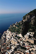The steep hillside overlooking the sea with the town of Atrani on the Amalfi Coast, Italy.