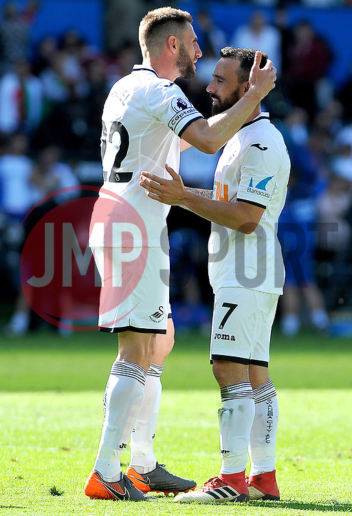 Angel Rangel of Swansea City praises Leon Britton of Swansea City at the final whistle -Mandatory by-line: Nizaam Jones/JMP- 13/05/2018 - FOOTBALL - Liberty Stadium - Swansea, Wales - Swansea City v Stoke City - Premier League