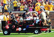 MINNEAPOLIS, MINNESOTA - SEPTEMBER 10:  Head coach Jerry Kill of the Minnesota Golden Gophers is carted off the field after suffering an epileptic seizure during the fourth quarter of his team's game against the New Mexico State Aggies at TCF Bank Stadium on September 10, 2011 in Minneapolis, Minnesota.  (Photo by Sam Wasson)