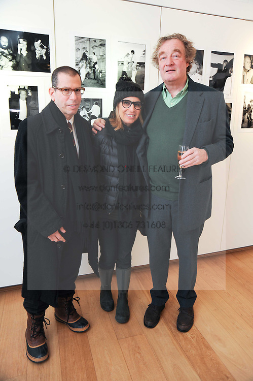 Left to right, JONATHAN & RONNIE NEWHOUSE and CHRISTOPHER SIMON SYKES at a private view of photographs by Nick Ashley held at the Sladmore Gallery, 32 Bruton Place, London on 13th January 2010.