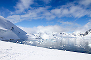 Icebergs and mountains of Cuverville Island near Antarctic Peninsula, Antarctica