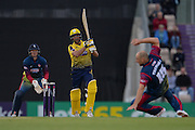 Kent Bowler James Tredwell takes evasive action as Hampshire T20 all rounder Shahid Afridi hits down the ground for a boundary during the NatWest T20 Blast South Group match between Hampshire County Cricket Club and Kent County Cricket Club at the Ageas Bowl, Southampton, United Kingdom on 2 June 2016. Photo by David Vokes.