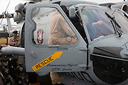 US Navy pilot shows guests around the cockpit of their Sikorsky MH-60R helicopter at the Farnborough Airshow. ..The MH-60R is the U.S. Navy's newest and most advanced multi-mission helicopter, designed for anti-submarine and surface warfare (ASW/ASuW). Secondary missions include: Search and Rescue, anti-ship surveillance and targeting, communication relay and medevac/vertical replenishment. The Sikorsky-built helicipter with integrated avionics and mission systems by Lockheed Martin.