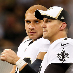 Aug 28, 2014; New Orleans, LA, USA; New Orleans Saints quarterback Luke McCown (right) talks with tight end Jimmy Graham (left) during the first half of a preseason game against the Baltimore Ravens at Mercedes-Benz Superdome. Mandatory Credit: Derick E. Hingle-USA TODAY Sports