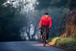 Male Cyclist Cycling on Country Road