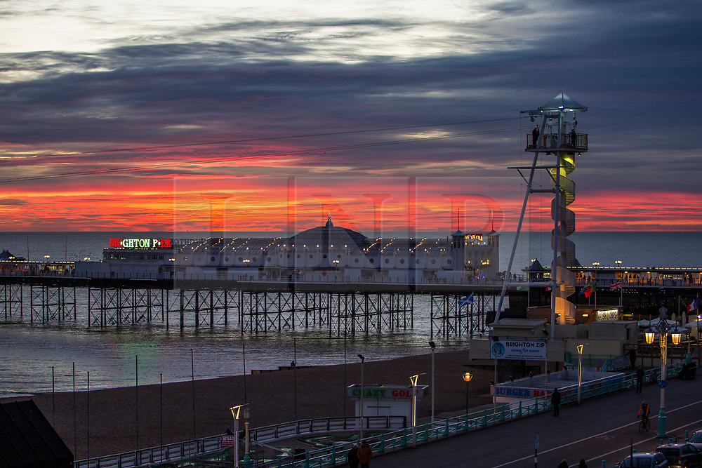 © Licensed to London News Pictures. 13/11/2017. Brighton, UK. A colourful sky hangs over Brighton and Hove at sunset, today 13th November 2017. Photo credit: Hugo Michiels/LNP
