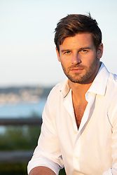 good looking man at sunset in an open white shirt