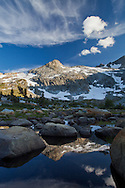 Mt. Davis is reflected amongst the boulders in Davis Lake, Ansel Adams Wilderness
