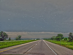 A look through the windshield at a thunderstorm while driving in the rain on an interstate in southern Illionis<br />