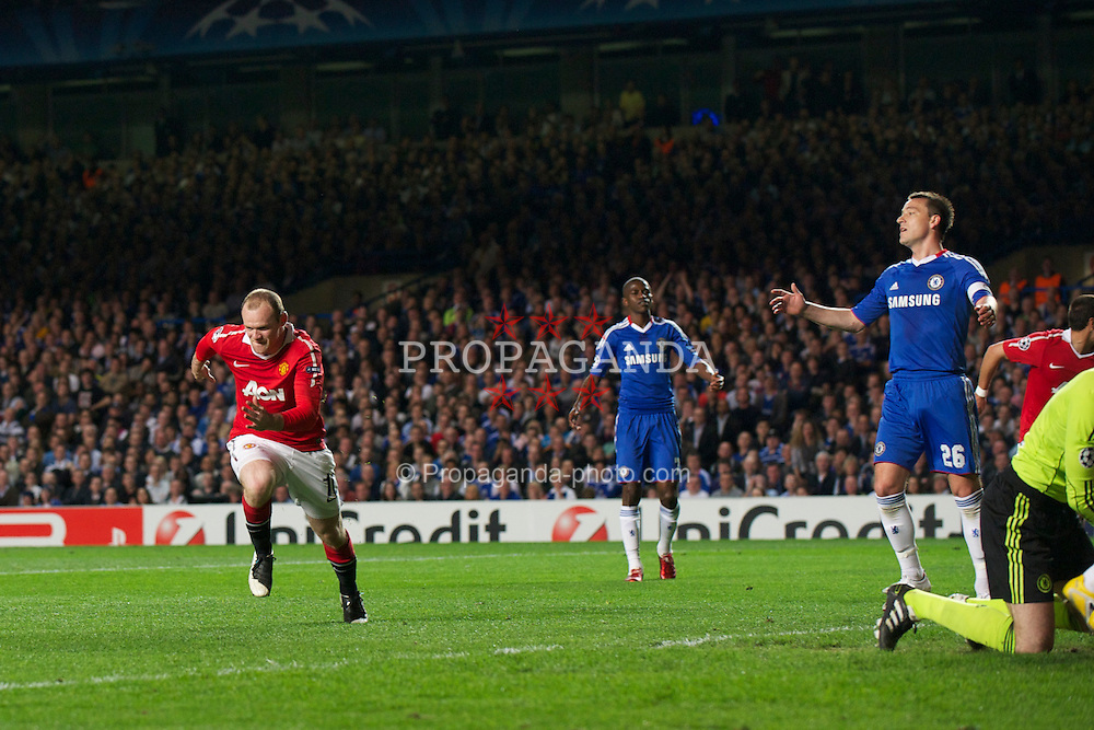 LONDON, ENGLAND, Wednesday, April 6, 2011: Manchester United's Wayne Rooney celebrates scoring the first goal against Chelsea during the UEFA Champions League Quarter-Final 1st leg match at Stamford Bridge. (Photo by David Rawcliffe/Propaganda)
