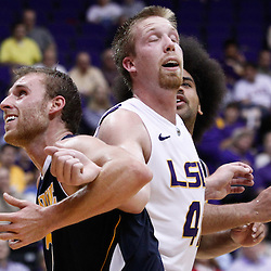 December 15, 2011; Baton Rouge, LA; UC Irvine Anteaters forward Adam Folker (20) ties up LSU Tigers center Justin Hamilton (41) during the second half of a game at the Pete Maravich Assembly Center. LSU defeated UC Irvine 66-59.  Mandatory Credit: Derick E. Hingle-US PRESSWIRE