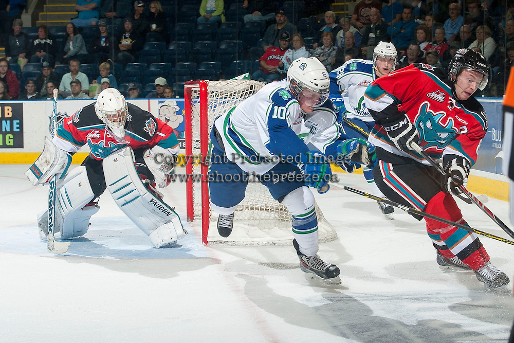 KELOWNA, CANADA - OCTOBER 7: Colten Martin #8 of Kelowna Rockets tries to pass the puck against Colby Cave #10 of Swift Current Broncos on October 7, 2014 at Prospera Place in Kelowna, British Columbia, Canada.  (Photo by Marissa Baecker/Getty Images)  *** Local Caption *** Colten Martin; Colby Cave;