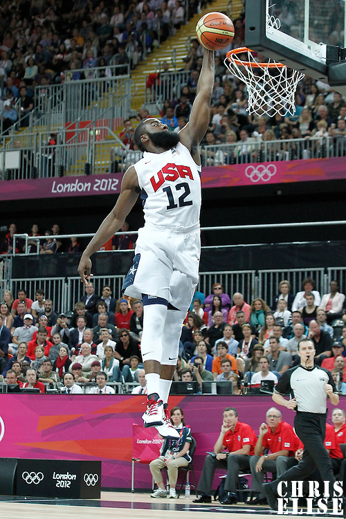 29 July 2012: USA James Harden dunks the ball during the 98-71 Team USA victory over Team France, during the men's basketball preliminary, at the Basketball Arena, in London, Great Britain.