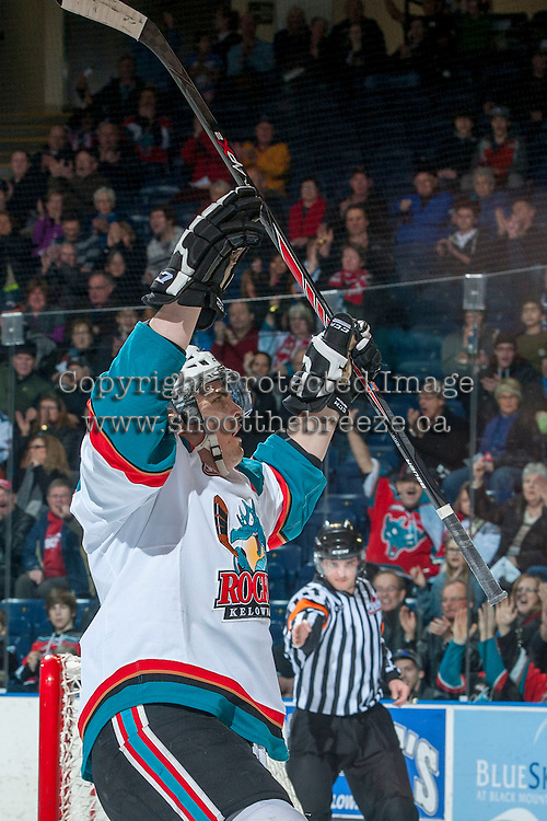 KELOWNA, CANADA -FEBRUARY 8: Carter Rigby #11 of the Kelowna Rockets celebrates a goal against the Victoria Royals on February 8, 2014 at Prospera Place in Kelowna, British Columbia, Canada.   (Photo by Marissa Baecker/Getty Images)  *** Local Caption *** Carter Rigby;