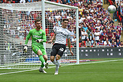 Aston Villa goalkeeper Jed Steer (12) clears under pressure from Derby County midfielder Tom Lawrence (10) during the EFL Sky Bet Championship play off final match between Aston Villa and Derby County at Wembley Stadium, London, England on 27 May 2019.