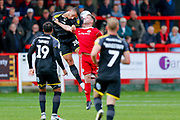 Wimbledon defender Rod McDonald (26) challenges Accrington Stanley forward Billy Kee (29)  during the EFL Sky Bet League 1 match between Accrington Stanley and AFC Wimbledon at the Fraser Eagle Stadium, Accrington, England on 22 September 2018.