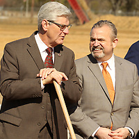 Gov. Phil Bryant, left, chats with General Atomics Electromagnetic Systems Group President R. Scott Forney III before they help officially break ground for the new expansion at General Atomics plant in Shannon on Wednesday..