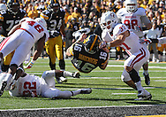 October 22, 2011: Iowa Hawkeyes quarterback James Vandenberg (16) is hit by Indiana Hoosiers cornerback Kenny Mullen (22) and Indiana Hoosiers linebacker Mark Murphy (37) as he scrambles with the ball during the first half of the NCAA football game between the Indiana Hoosiers and the Iowa Hawkeyes at Kinnick Stadium in Iowa City, Iowa on Saturday, October 22, 2011. Iowa defeated Indiana 45-24.