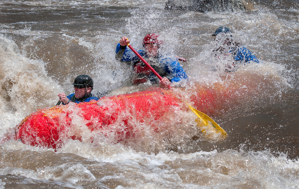 em051617b/jnorth/Will Graves, left, Robert Bell, center, and John Adams, all with the Santa Fe County Fire Department, raft through the rapid know as Toilet Bowl on the Rio Grande Racecource on their day off, Tuesday May 16, 2017. The river is running at over 3100 cubic feet per second, almost twice its average. This is the same rapid that Governor Gary Johnson got stuck in in 2001. (Eddie Moore/Albuquerque Journal