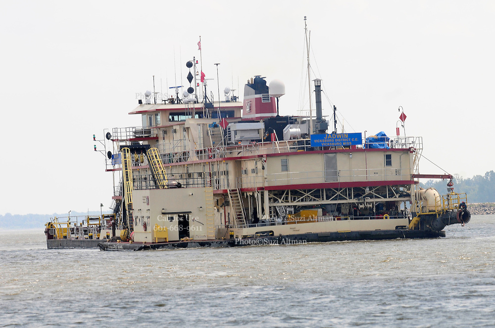 {8/24/12} {10pmCST}  Greenville , MS, U.S.A. -- The Dredge JADWIN, part of the US Army Corp of Engineers, is pictured outside of Greenville MS. on the Mississippi River where it is clearing sand to keep the river open to barge traffic.Sandbars creep up as the water level drops on the Mississippi River makeing navigating the Mississippi River difficult for tug boat captains, Friday August 24,2012. Historically low river levels on the Mississippi River are causing havoc on river traffic: grounding barges loaded with grain and fertilizer, traffic jams several miles long and forcing the Coast Guard to close down chunks of the river due to groundings. The area around Greenville, Miss., has closed three times the past week due to groundings. Last year, there were five total groundings the entire low-water season. Locals who fought historic high-water floods last year are this year engaged in a different fight: keeping barges afloat on a vanishing Mississippi.Photo©Suzi Altman, Freelance.