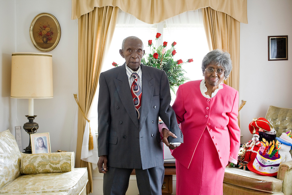 Herbert and Zelmyra Fisher celebrated their 85th anniversary May 13 and hold the Guinness World Record for the longest marriage. Zelmyra is 101 years old; Herbert turned 105 June 10. The couple, pictured here in their living room Aug. 14, have shared the same home in the Brownsville community of New Bern for 50 years.