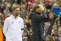 14.04.2016, Anfield Road, Liverpool, ENG, UEFA EL, FC Liverpool vs Borussia Dortmund, Viertelfinale, Rueckspiel, im Bild Trainer Juergen Klopp (FC Liverpool) schmunzelt waehrend Trainer Thomas Tuchel (Borussia Dortmund) sich enttaeuscht die Haende vor den Kopf schlaegt // during the UEFA Europa League Quaterfinal, 2nd Leg match between FC Liverpool vs Borussia Dortmund at the Anfield Road in Liverpool, Great Britain on 2016/04/14. EXPA Pictures &copy; 2016, PhotoCredit: EXPA/ Eibner-Pressefoto/ Schueler<br /> <br /> *****ATTENTION - OUT of GER*****
