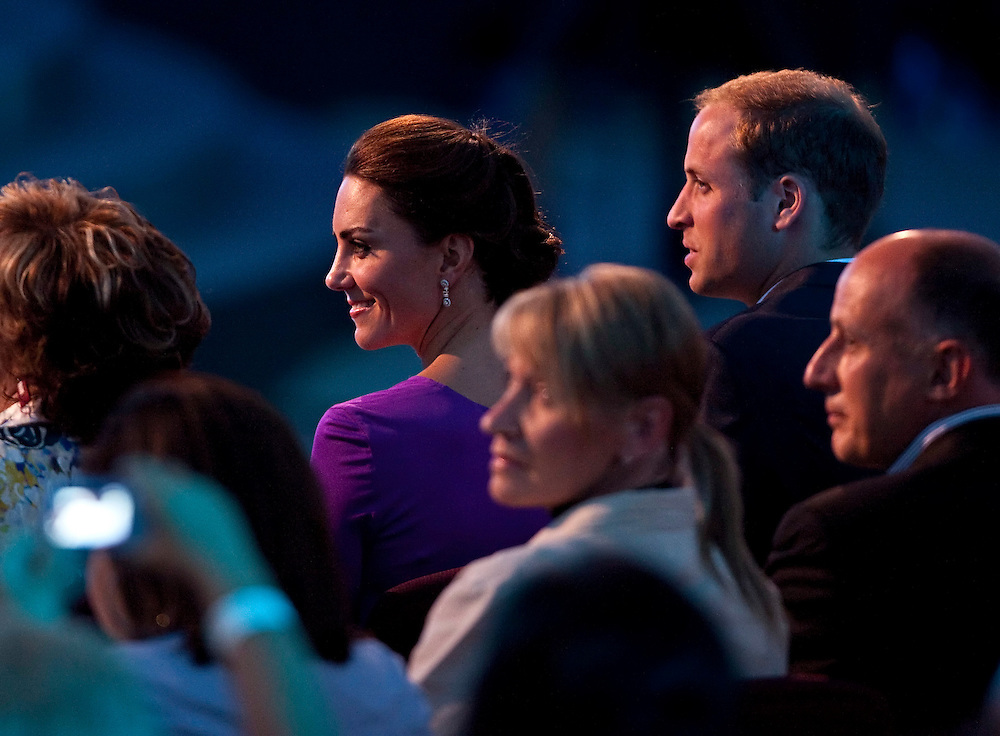 Britain's Prince William and his wife Catherine the Duchess of Cambridge watch performers in the evening Canada Day show on Parliament Hill in Ottawa, Canada, July 1, 2011. The Duke and Duchess are on a nine day tour of Canada, their first official foreign trip as husband and wife.<br /> AFP PHOTO/GEOFF ROBINS
