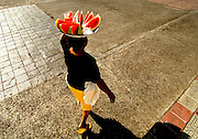 Woman carrying watermelon for sale on her head in Leon, Nicaragua