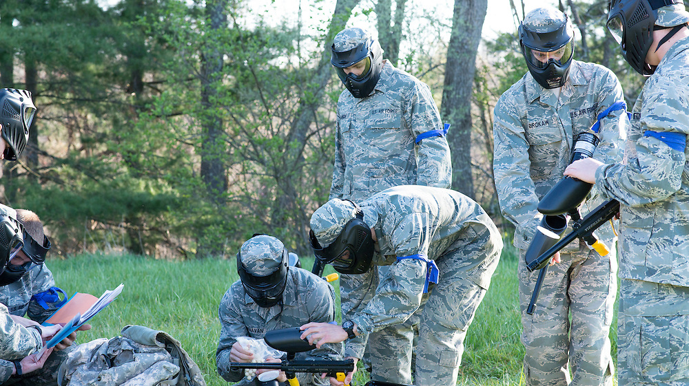 Airforce ROTC cadets load their paintball guns with ammunition in preparation for their mobile exercise on April 16, 2016. Each team was given a limited number of paintballs which needed distributed evenly amongst their members. Photo by Ohio University / Kaitlynn Stone