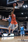 Cal State Fullerton Titans guard Tory San Antonio (23) goes in for a layup against San Diego Toreros guard Finn Sullivan (5) during an NCAA basketball game, Wednesday, Dec. 11, 2019, in Fullerton, Calif. San Diego defeated CSUF 66-54. (Jon Endow/Image of Sport)