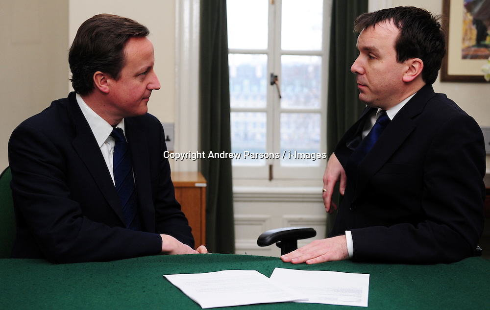Leader of the Conservative Party David Cameron with Andrew Griffiths, Member of Parliament for Burton in his office in Norman Shaw South, January 5, 2010. Photo By Andrew Parsons / i-Images.