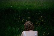 Melissa among tall roadside grasses in Eastlake, Ohio on July 1, 2006.