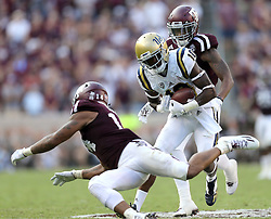 UCLA wide receiver Kenneth Walker III (10) catches a pass then evades Texas A&M Justin Evans (14) and Nick Harvey (1) for a 62 yard catch and run touchdown during the fourth quarter of an NCAA college football game against Saturday, Sept. 3, 2016, in College Station, Texas. Texas A&M won 31-24 in overtime. (AP Photo/Sam Craft)